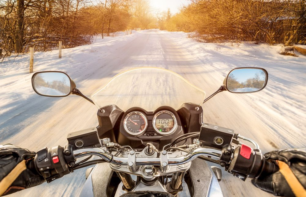 Motorcycle driving down the road